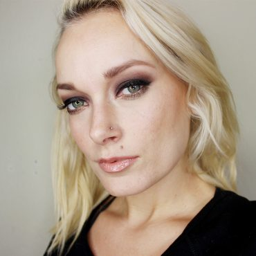 Dark eye makeup with thick winged liner and fluffy false lashes