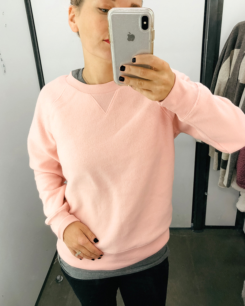 This cozy and fuzzy light pink sweater is perfect for cold weather. It can be layered with a jacket or worn alone for a cute fall look