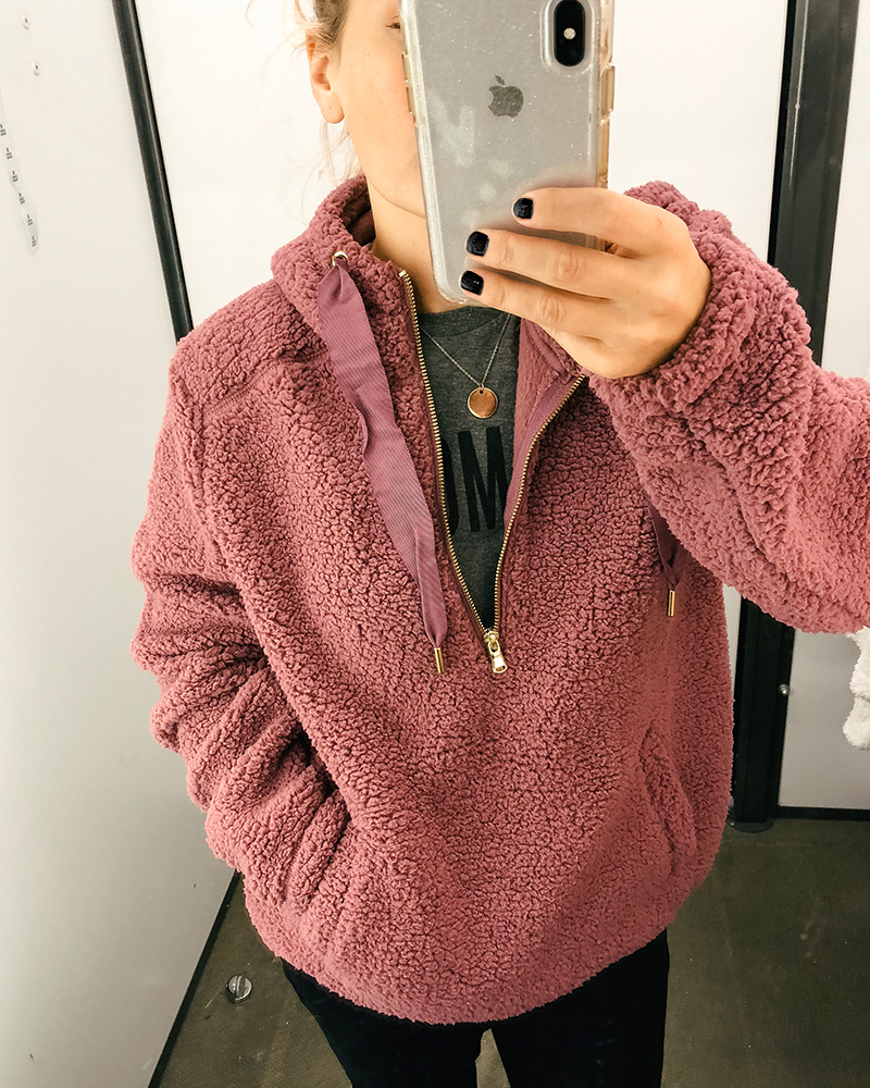 This cozy pink sherpa sweater is so comfortable and easy to wear for fall. Just throw it over a t-shirt, add a scarf and you are set for crips fall days.