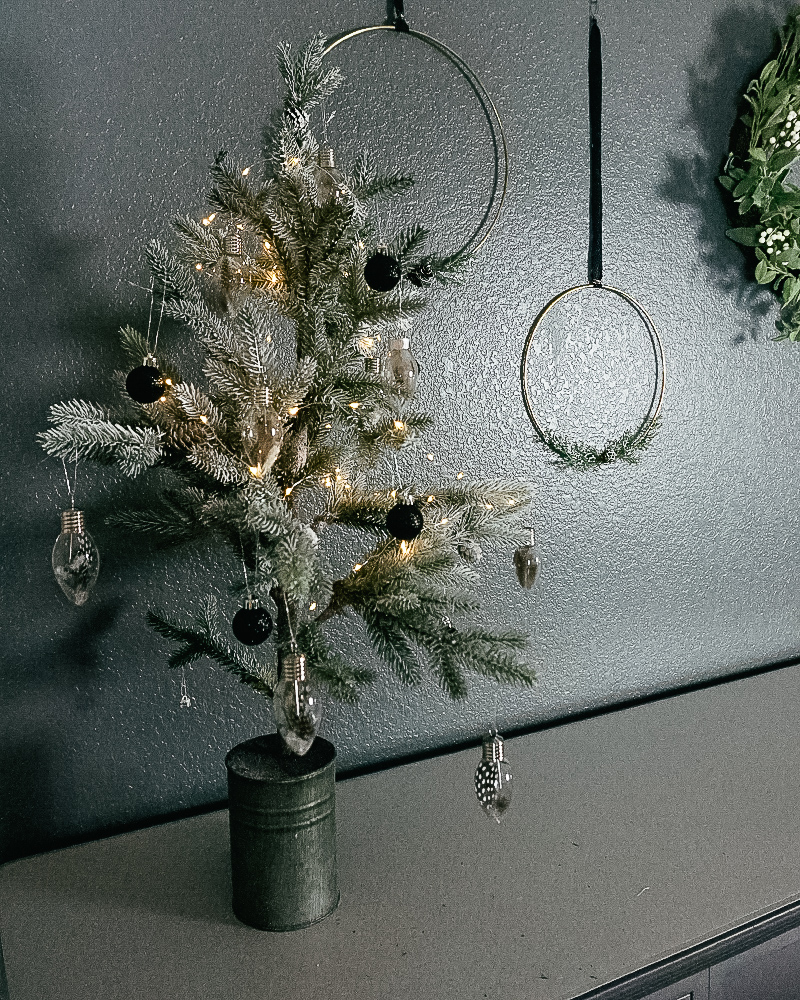 Dining Room Christmas Decor for a mid-century inspired holiday home with wire hoop wreaths and modern christmas tree decorations with beauty and lifestyle blogger, Kendra Stanton.