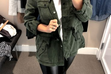 the loft fall try on session for petite sizing green utility jacket and faux black leather leggings