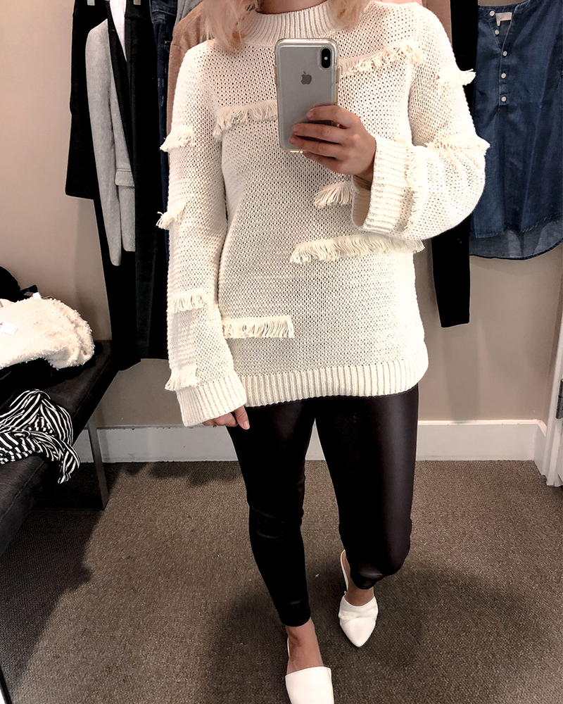 the loft fall try on session for petite sizing with faux leather pants and a cozy white sweater with frindge details.