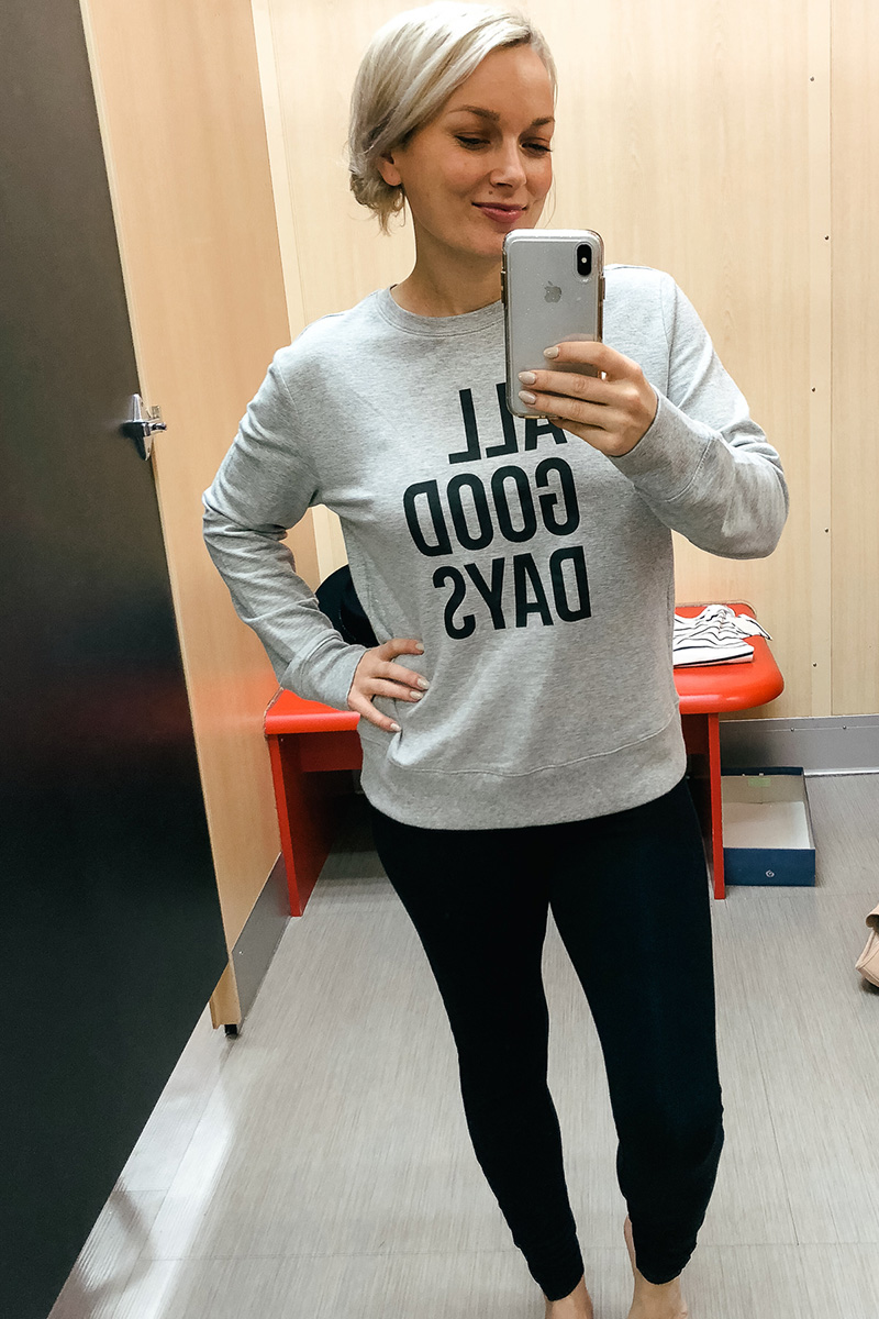 February Target Try on Haul universal threads ripped denim, wild and fable All Good Days Sweatshirt and black leggings with Austin, TX style and beauty blogger, Kendra Stanton.