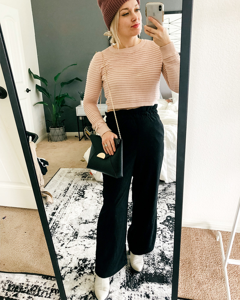 Austin, TX Beauty and, Lifestyle blogger show's you different ways to style clothes from her March HnM Shopping Haul featuring cropped pink sweater and wide leg and high-waisted black pants.