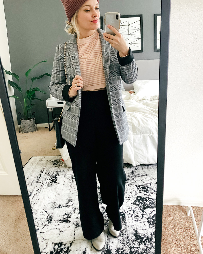Austin, TX Beauty and, Lifestyle blogger show's you different ways to style clothes from her March HnM Shopping Haul featuring cropped pink sweater under a blazer and wide leg and high-waisted black pants.