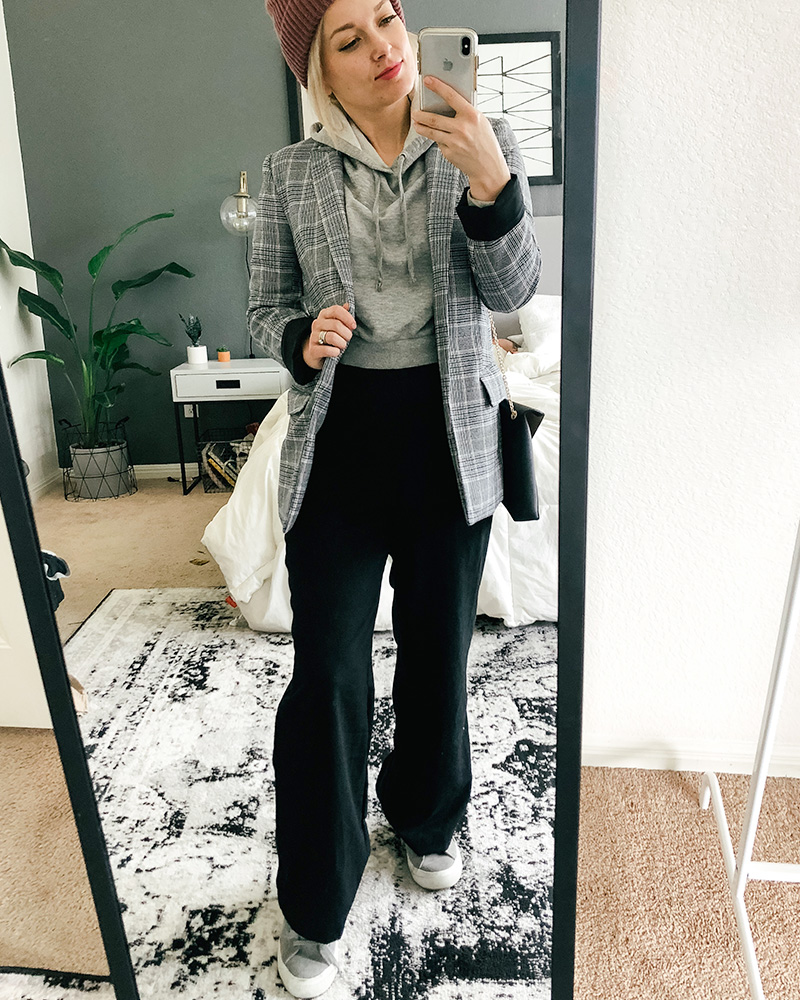 Austin, TX Beauty and, Lifestyle blogger show's you different ways to style clothes from her March HnM Shopping Haul featuring grey cropped sweater and wide leg and high-waisted black pants with blazer.