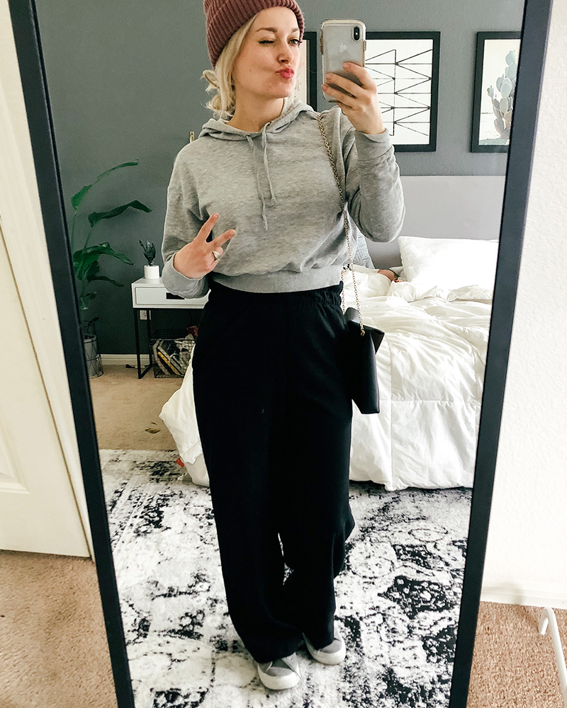 Austin, TX Beauty and Lifestyle blogger shows you different ways to style clothes from her March H&M Shopping Haul featuring cropped pink sweater and wide leg and high-waisted black pants.
