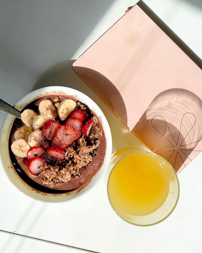 Acai berry bowl is a superfood breakfast that's healthy and full of berries, gluten-free granola and more. Get this easy recipe with beauty and lifestyle blogger, Kendra Stanton.