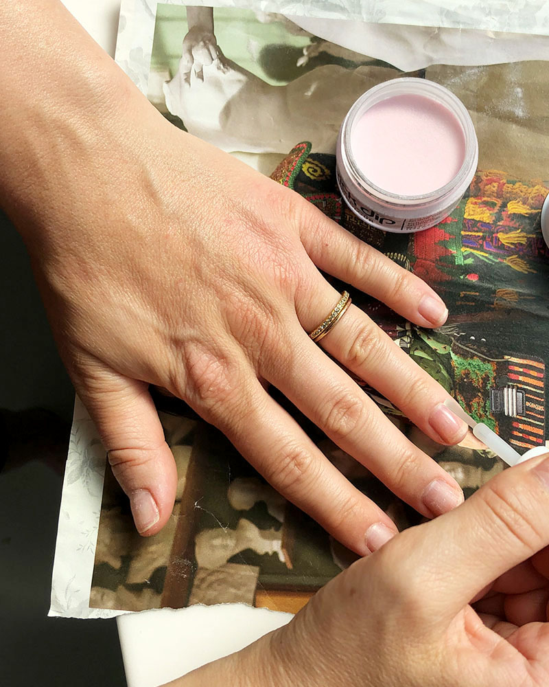 Prep your nail for DIY dip nail with alcohol or SNS prep solution.