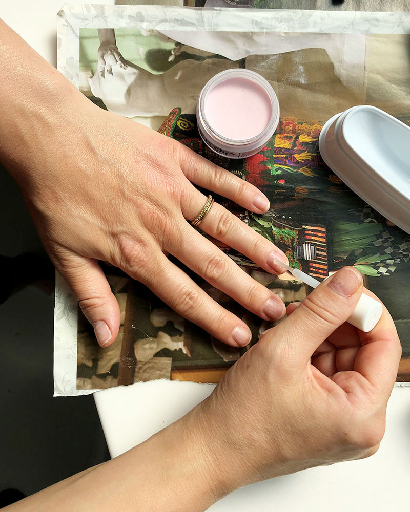 Step three for DIY dip nail, make sure to spread the resin or base coat down the center of your nail avoiding the base and the sides. You want to stay right in the center.