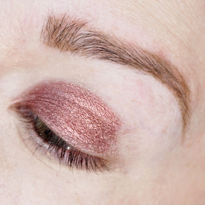 Rose Gold Holiday makeup look step one. Apply Rose Gold eyeshadow to 1/3 of your lower eyelid.