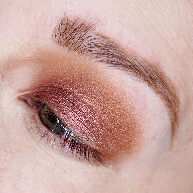 Step 2 rose gold holiday makeup look. Use a light brown eyeshadow and sweep it into the contour of your eye.