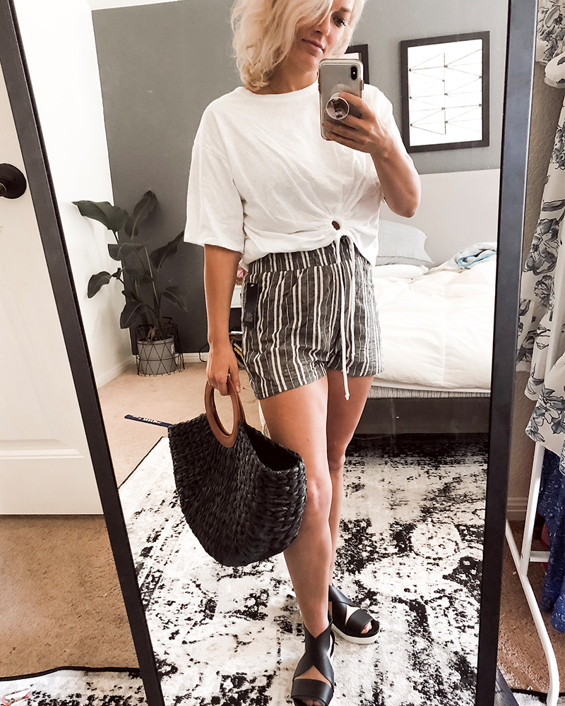 Striped high-waisted shorts with white t-shirt and black weaved handbag for summer from Target Style with style blogger, Kendra Stanton.